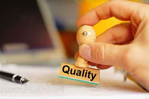 Hand checks a translation document with approved quality stamp